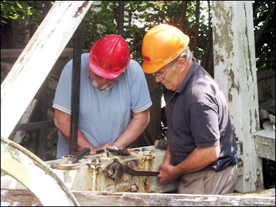 Alain Beaupain and Jim Pointer working on the fantail carriage
